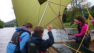 Family canoe sailing