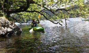 Kayaking on Coniston Water under trees